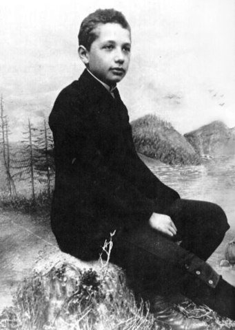 Albert Einstein at age 14 sitting on a rock in 1893.