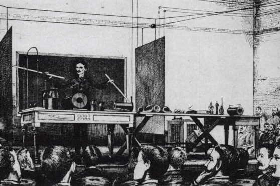 "Tesla demonstrating wireless lighting by ""electrostatic induction"" in 1891."